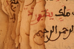 Image of damaged pages from a manuscript in Timbuktu showing the effects of the gradual loss of paper. Photo credit: Alexio Motsi and Mary Minicka for the Timbuktu Manuscripts Project.