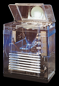 To prove to skeptical New York World's Fair visitors that no trickery was involved in creating television images, a special order was made to RCA's engineering wing to build a transparent version of Vassos' TRK-12 cabinet. The cabinet was constructed from DuPont's new Lucite plastic, giving viewers a clear picture of the set's inner workings.