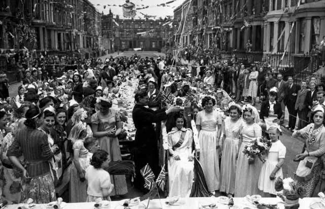 Up and down the land, her subjects celebrated at street parties complete with their own queen. At this one in Kensington, London, 14-year-old Maureen Atkins was 'crowned'  by the local vicar. Some 253 children attended enjoying a magic show, clowns and cake. They were later given a 15 shilling savings certificate.